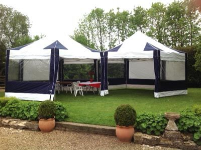 2 3m by 3m hex pop up tents together